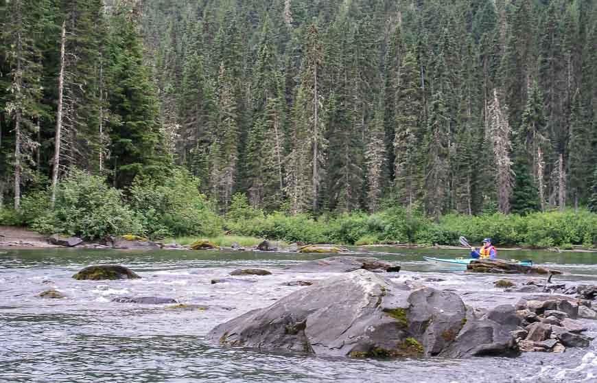 John running rapids in a kayak to avoid a portage