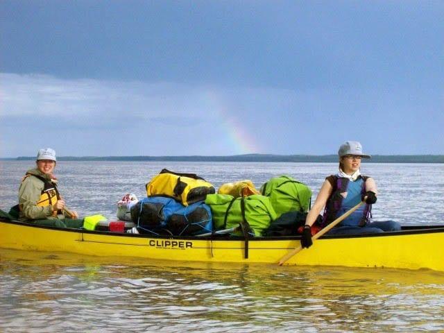 """A heavily laden canoe on the Mackenzie River"""