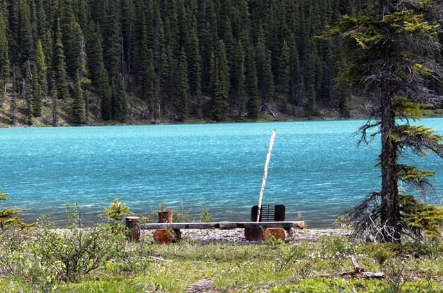 """A bench with a view of Maligne Lake"""