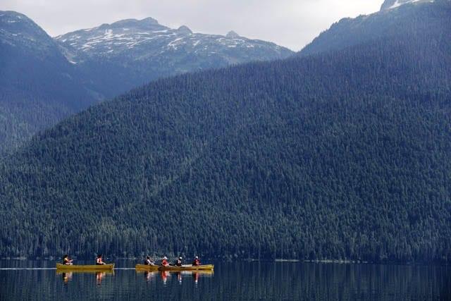 """Three canoes paddling on Murtle Lake"""