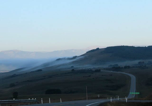 """Early morning fog along the highway"""