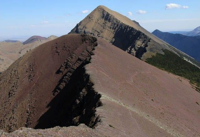 """The trail hugs the ridge"""