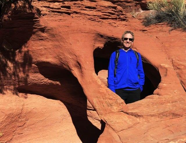 """John climbing through an interesting rock formation"""