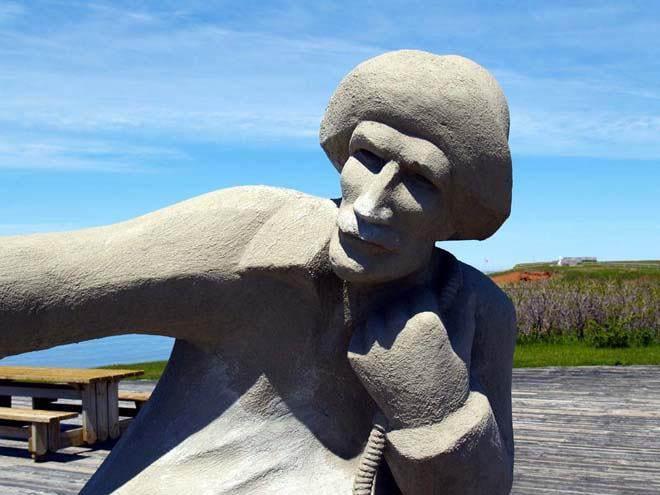 """Close-up of stone fisherman"""