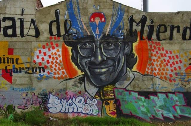 """Grafitti on a road into downtown Bogota"""
