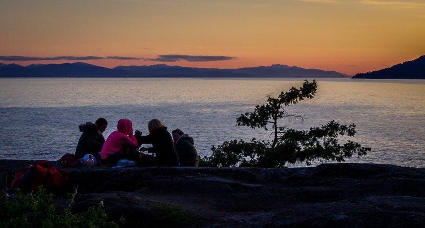 A group enjoying the setting sun
