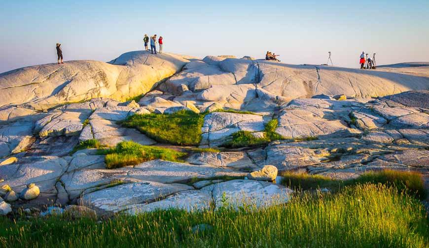 People look like ants on the rocks around Peggys Cove
