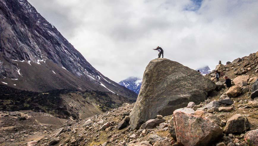 Guys being guys on big rocks