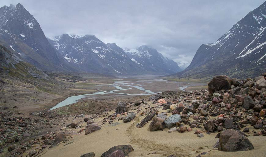 Crossing the Arctic Circle on Baffin Island offers a view up the Weasel River towards Mount Overlord