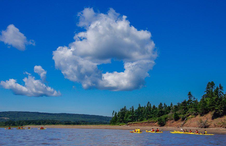 Kayaking Hopewell Rocks towards the donut shaped cloud