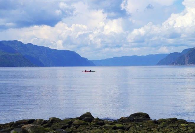 """kayak paddlers on the Saguenay fjord"""