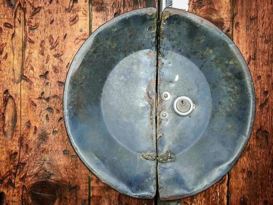 Gold pan re-purposed as a door handle