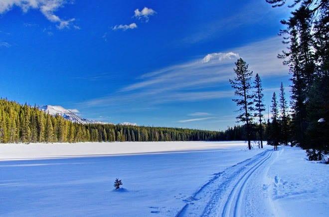 """""""Lovely skiing alongside a frozen lake"""""""
