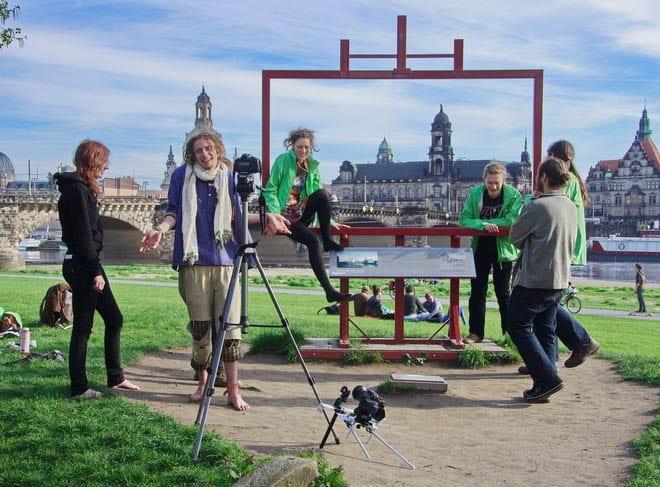 """Greenpeace members working on a photo shoot"""