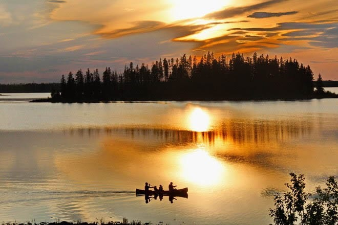 """Canoeing at sunset in Elk Island National Park"""