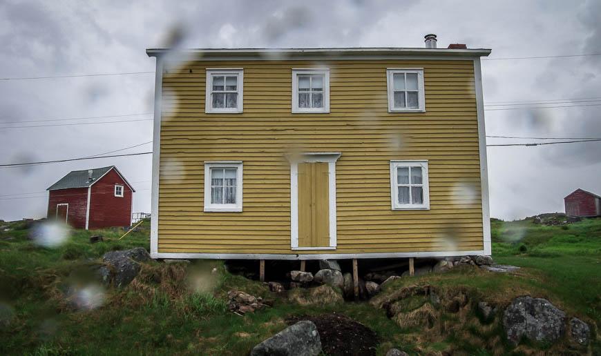 Yellow house seen throughthe raindrops