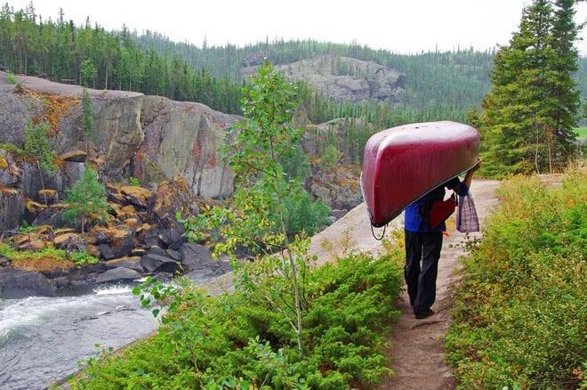 """Portaging beside Cameron Falls"""