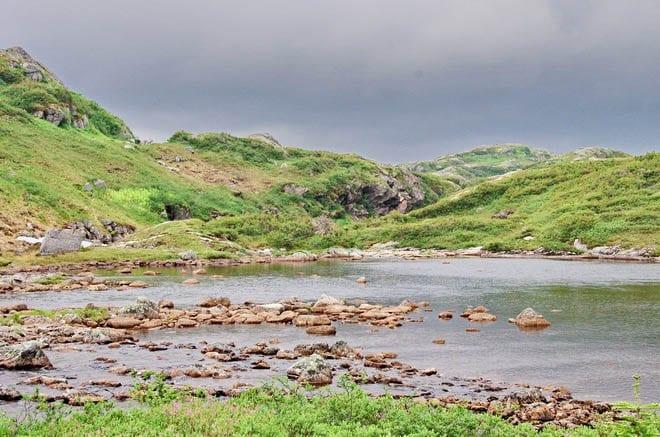 """rock-hopping a river on the Long Range Traverse"""