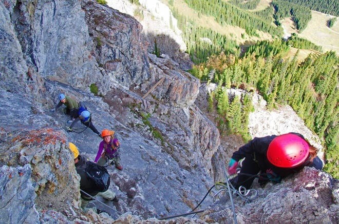 """plastered against therock wall on Banff's Via Ferrata"""