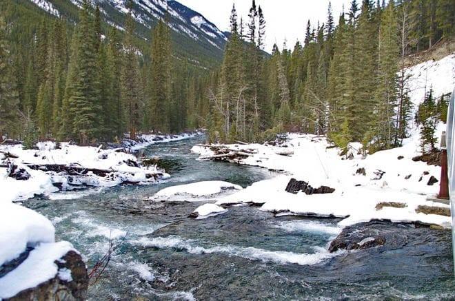 Walk beside great slabs of rock along the Spray River