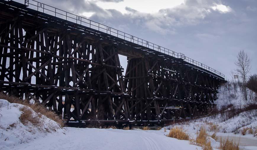 Ski under an old wooden trestle bridge