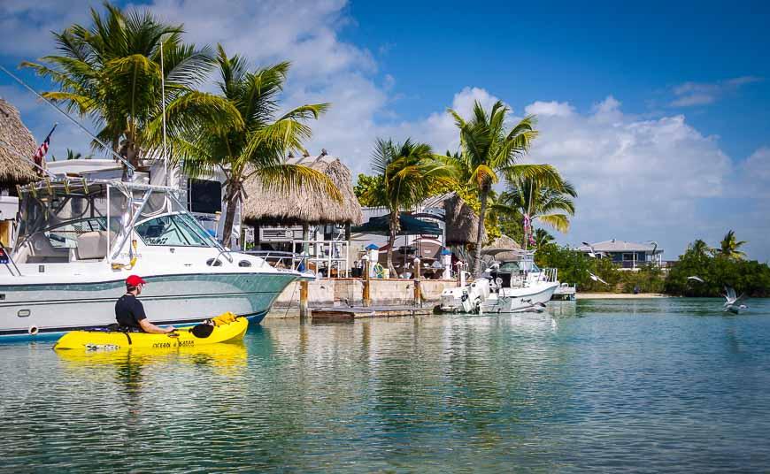 Start the Florida Keys kayaking tour by paddling past homes/boats on Geiger Key