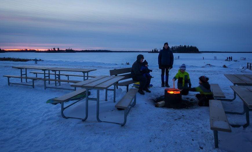 Enjoying a winter bonfire by Astotin Lake