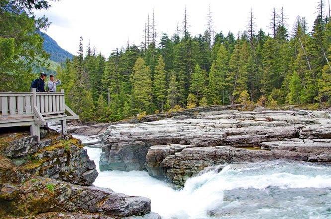 Admiring the falls above Lake McDonald