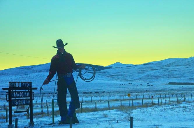 Cowboy near the turnoff to Bar U Ranch
