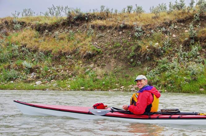 Paddling teh Milk River in a Trac kayak