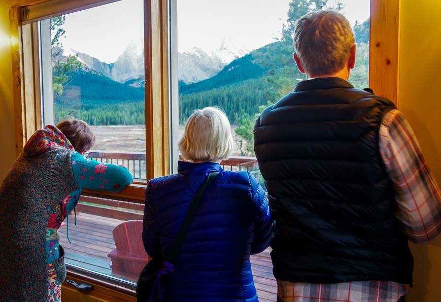 My mother-in-law, husband and guest moose viewing from inside Mount Engadine Lodge
