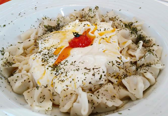 Manti - a pasta dish with a garlic- yogurt sauce is very popular