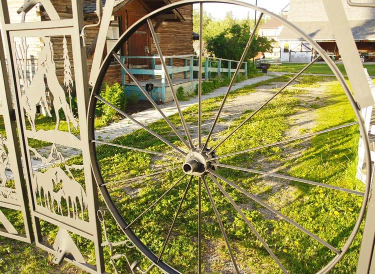 Looking through the wagon wheel into Pioneer Village