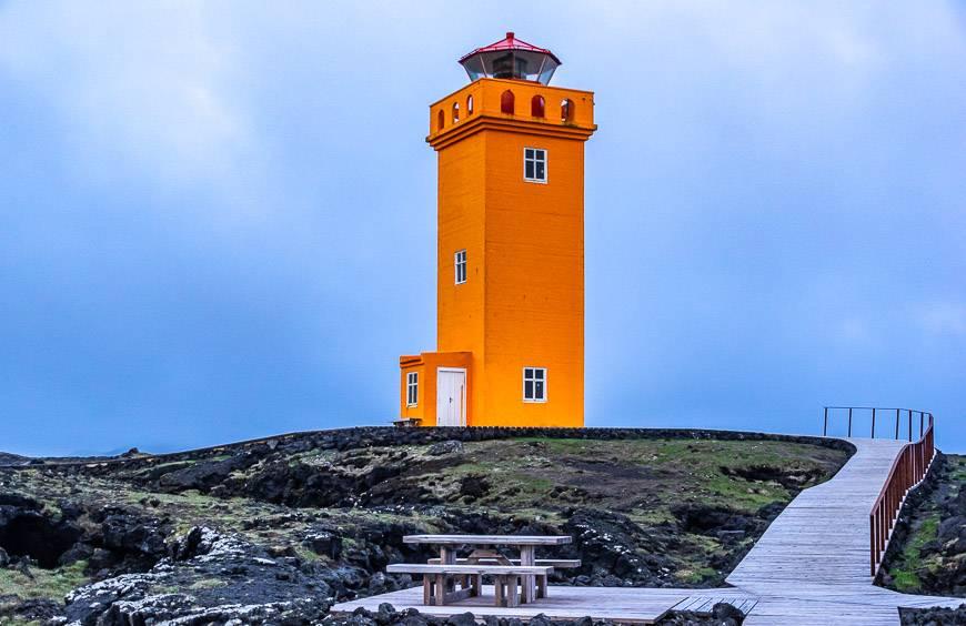 The bright orange lighthouse beside the Svortuloft bird cliffs
