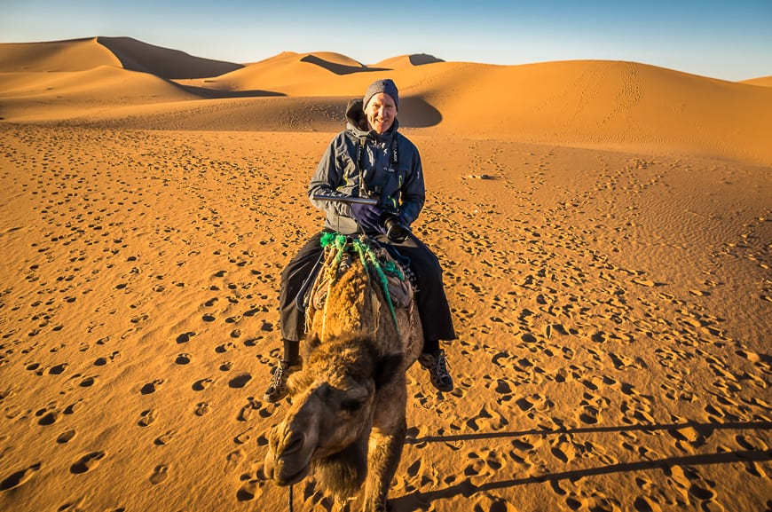 John on a camel in the Sahara Desert