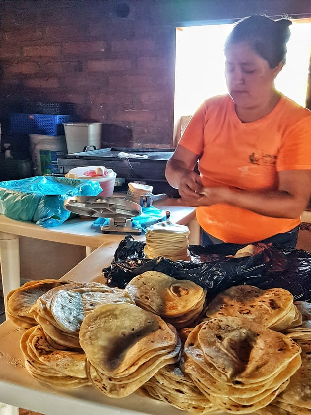 This lady was unbelievably fast making tortillas