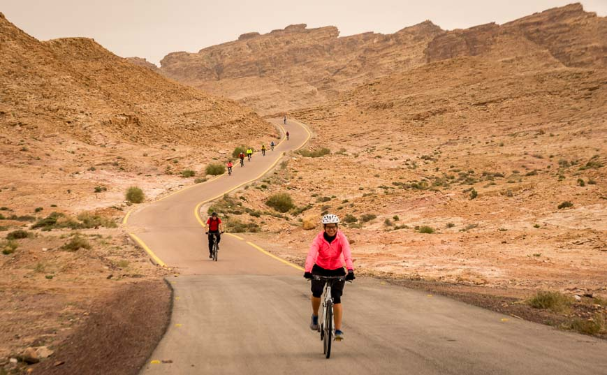 The final descent of the day cycling Jordan on the way to Aqaba