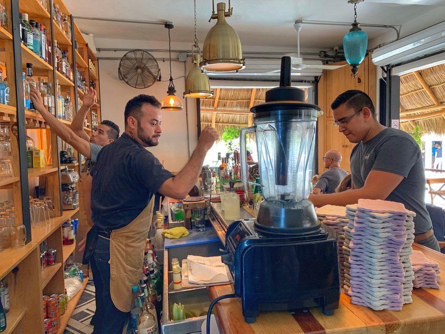 bartenders serve up drinks on cloth coasters at Barracuda Sayulita