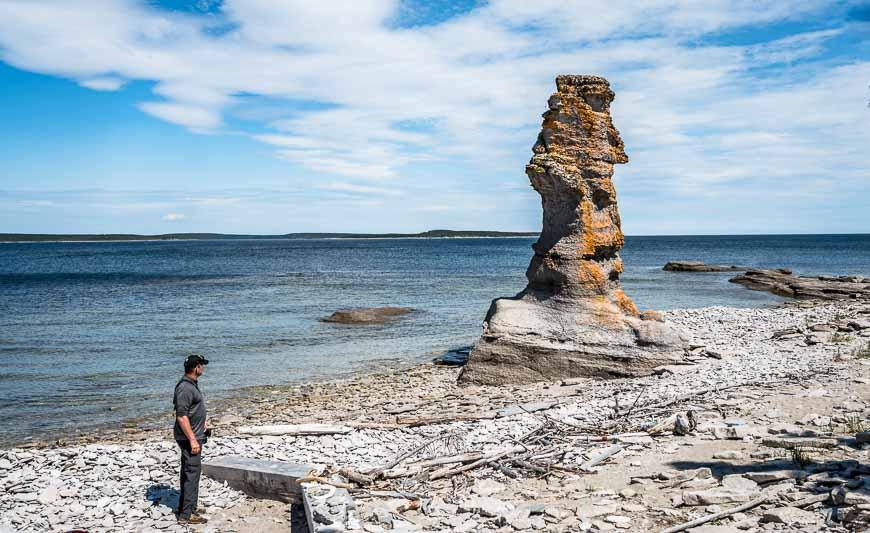 Man admiring a monolith on Ile Niapiskau in Mingan Archipelago National Park
