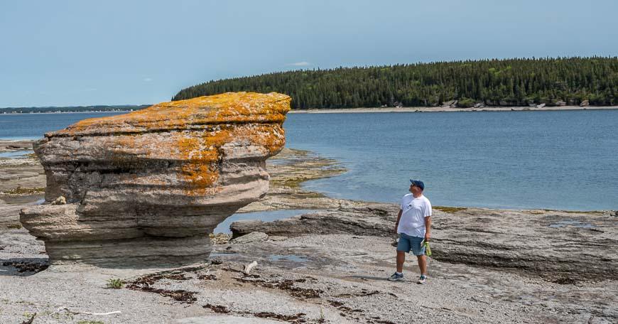 Admiring an erosion monolith in the Mingan Archipelago