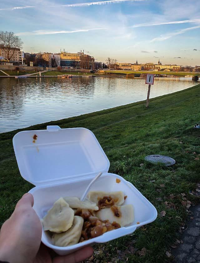 Enjoying a pierogi along the Vistula River