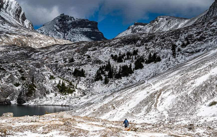 John hiking through snow on the way to the upper lake