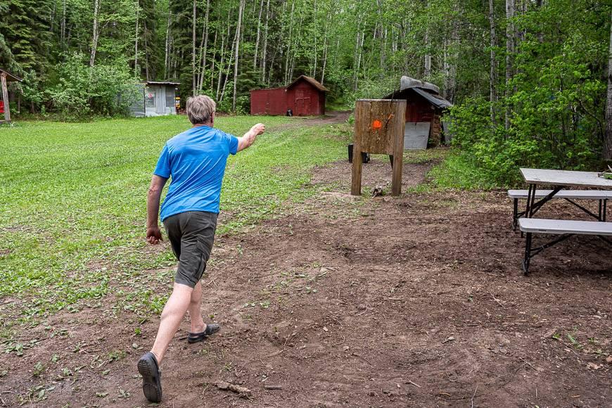 John practicing his axe throwing skills