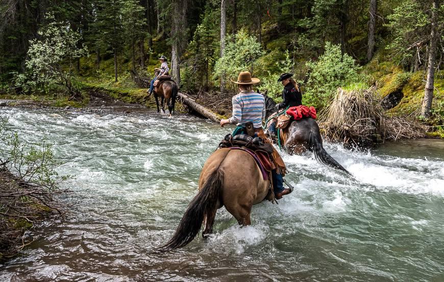 Crossing Brewster Creek on horseback